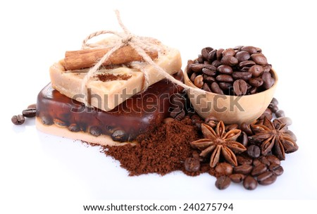 Organic soap with coffee beans and spices, isolated on white - stock photo