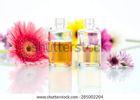Organic Spa concept with essential oil and pink Flowers - stock photo