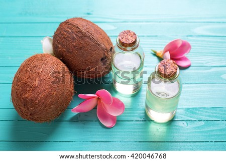 Organic spa products. Bottles with coconut oil on  bright  wooden background. Selective focus.  - stock photo