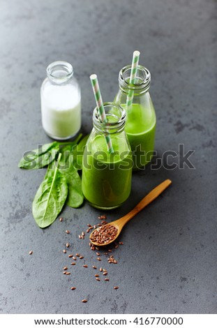 Organic spinach and almond milk smoothie with linseed - stock photo