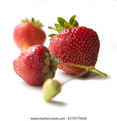 Organic strawberries on a white background - stock photo