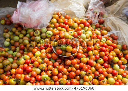 Organic tomatoes for sale on street market in Laocai, Vietnam.