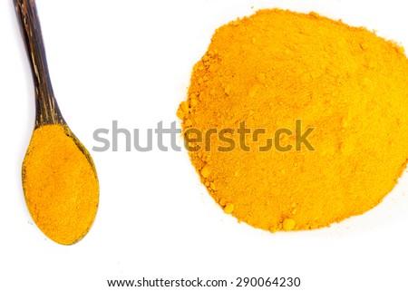 Organic turmeric (curcuma) powder with spoon isolated on white background - stock photo