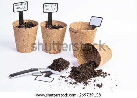 organic vases and dirt on white bacground - stock photo