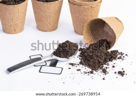 organic vases and dirt on white background - stock photo