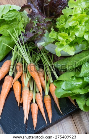 Organic vegetable on wooden background