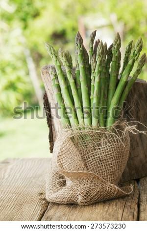 Organic vegetables. Fresh asparagus on wood. Fresh food - stock photo
