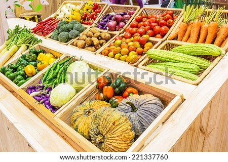 Organic vegetables in a basket on Shelf - stock photo