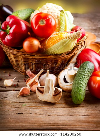 Organic Vegetables in the Basket on a Wooden Background. Healthy Vegetarian Food - stock photo