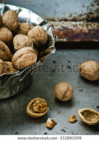 organic walnuts from a garden in a metal bowl. selective focus.