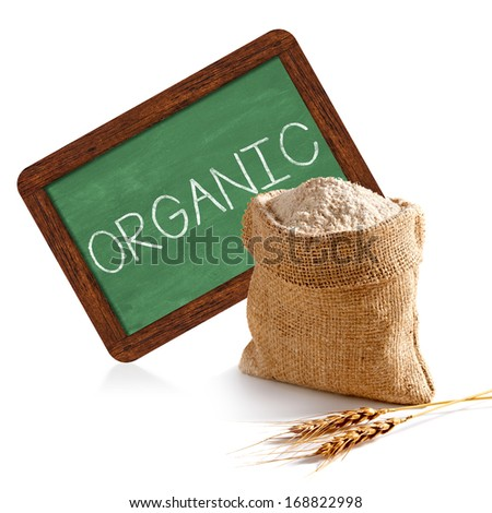 Organic whole flour with chalkboard sign on white background - stock photo