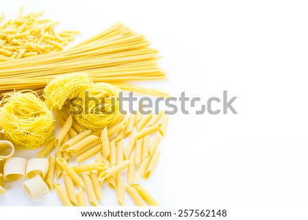 Organic yellow pasta on a white background.
