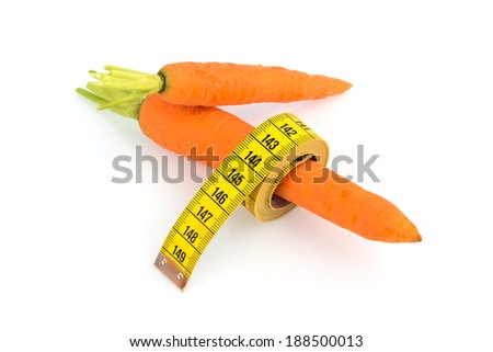 organically grown carrots with tape measure. fresh fruit and vegetables are always healthy. symbolic photo for a healthy diet.