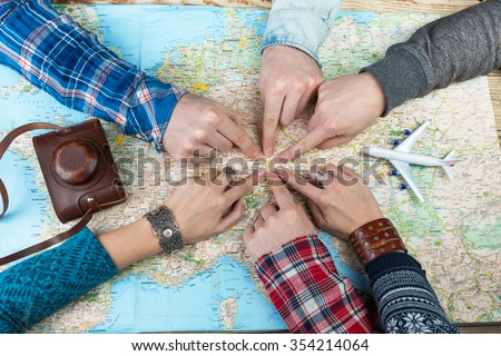 Organization of group travel. Desk Travel Agency. six Friends are going to visit Bavaria Germany Munich. Top view. Map and camera. - stock photo