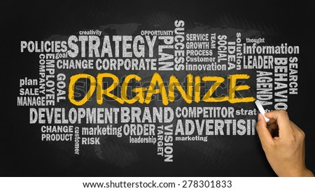 organize with related business word cloud handwritten on blackboard