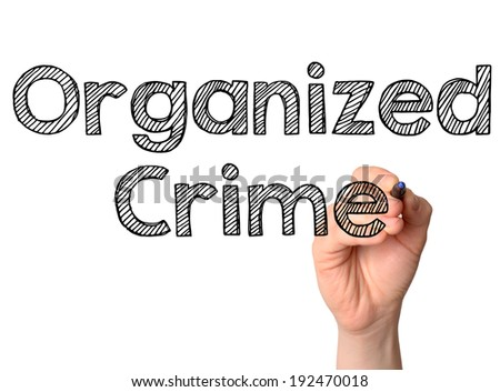 Organized Crime handwritten on white board - stock photo