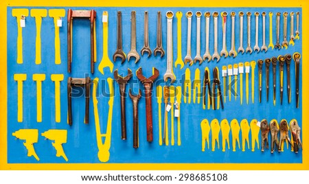 Organized tools on wall for maintenance - stock photo