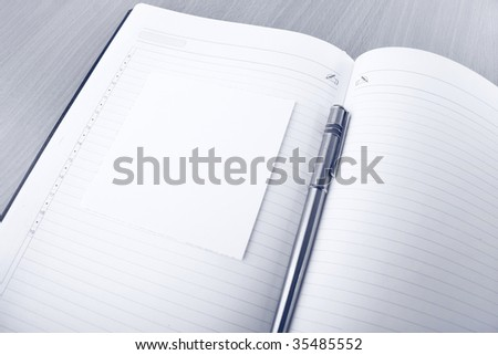Organizer, pencil and small paper on the table - stock photo