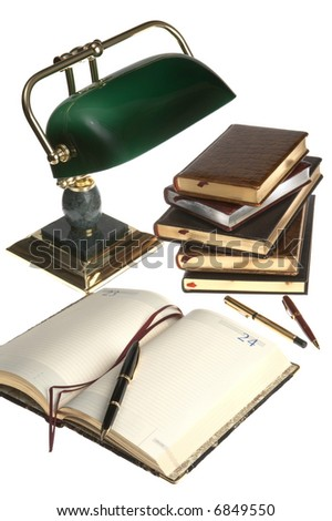 Organizer, pens, books and a lamp on a white background - stock photo