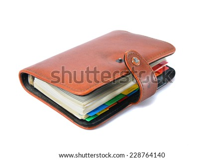 Organizer - weekly planner over white - stock photo