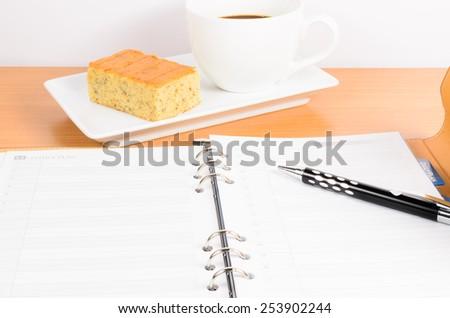 organizer with coffee and  cake ,coffee break - stock photo