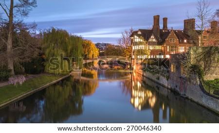 Orgasm Bridge over Cam River beside a building in Twilight of Cambridge, UK - stock photo
