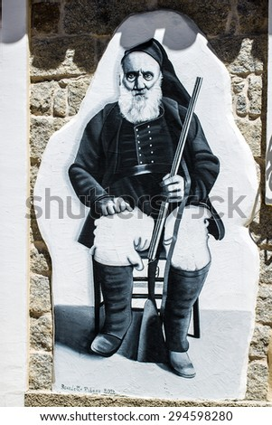 ORGOSOLO, ITALY - July 26, 2015 - typical wall paintings on the streets of Orgosolo, a small town in Sardinia, Italy