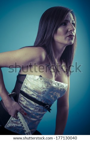 Oriental.Anime stylized brunette with short hair holding a katana sword with two hands - stock photo
