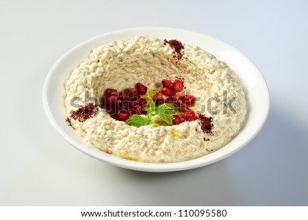 Oriental Arabic food hummus with pomegranate seeds. - stock photo