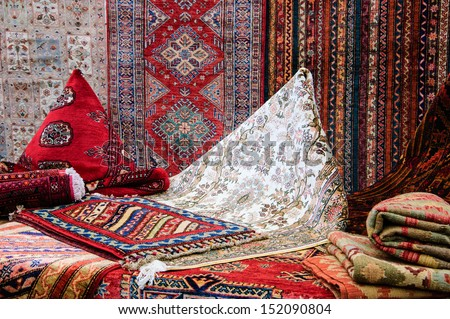 Oriental carpets in the market. - stock photo