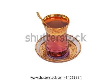 Oriental cup of tea with spoon - stock photo