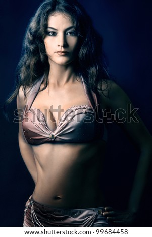 Oriental dancer fashion woman. Sexy dancer's dress and bra - stock photo