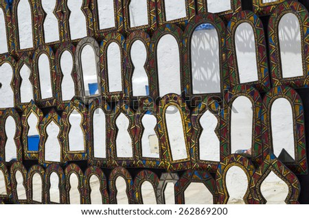 Oriental decorative mirrors hanging at market in Tunisia - stock photo