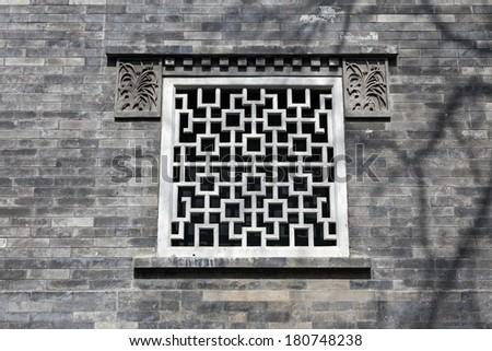 Oriental Design Window on the Grey Brick Wall - stock photo