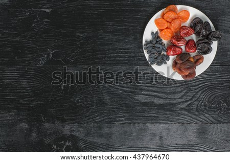 Oriental dried on a black wooden table - stock photo