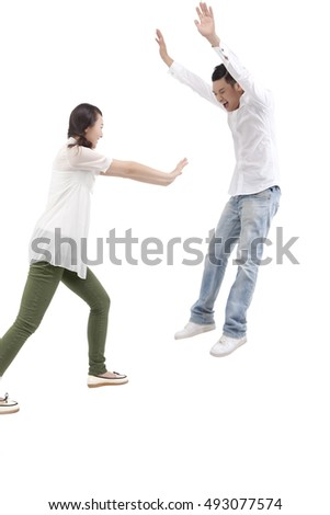 Oriental fashion young couple fighting