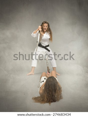 oriental fighting  with sword and gun, cloudy room - stock photo