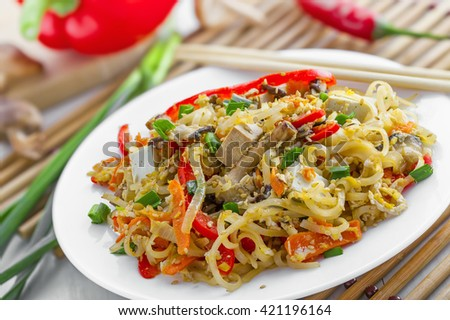 Oriental food made of rice noodles, tofu, vegetables and shiitake mushrooms. Delicious Oriental cuisine meal.