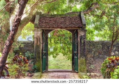 oriental gate in the tropical asian garden, Ninh Binh province, Vietnam