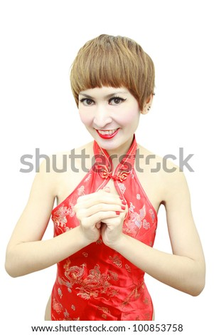 Oriental girl wishing you a happy Chinese New Year. - stock photo