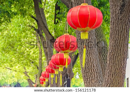 Oriental lanterns on trees - stock photo