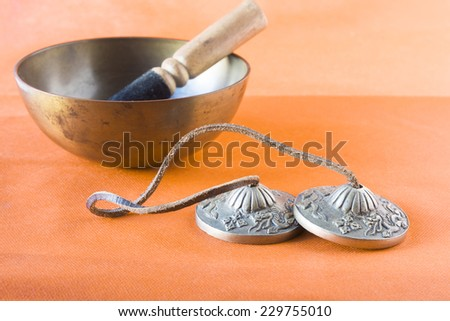 Oriental objects for alternative therapy isolated on orange background. - stock photo