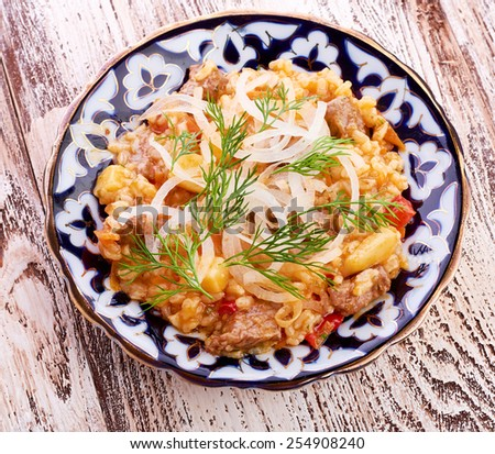 Oriental shah pilaf, pilaw, plov, rice with meat in pastry filo, delicious fragrant spicy dish - stock photo