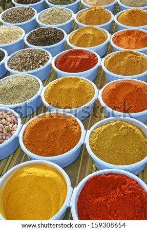 Oriental spice market-gorgeous setting with cooking spices and herbs  in ceramic bowls  - stock photo