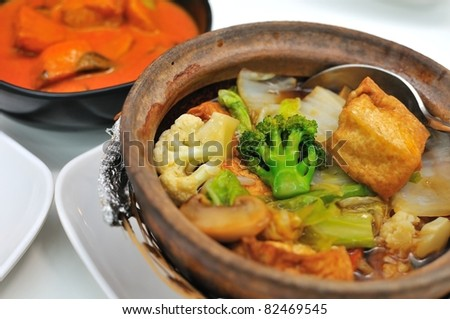 Oriental style vegetable claypot prepared from colorful and healthy ingredients.