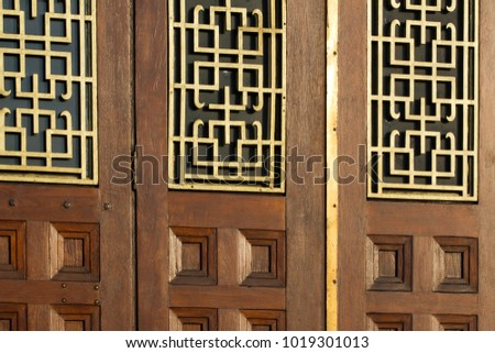 Oriental style window grill features on the doors of a Chinese restaurant in London UK & Oriental Style Window Grill Features On Stock Photo (Royalty Free ...