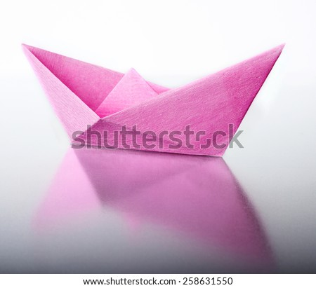 Origami a boat. - stock photo