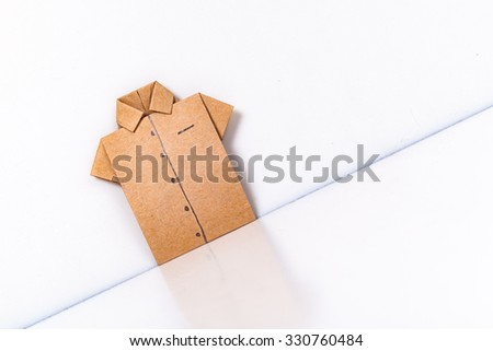 origami a man's shirt on a white background brown of paper - stock photo