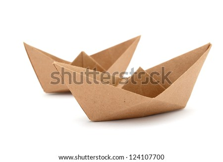 Origami boats by recycle paper on white background