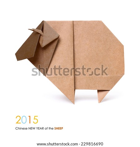 Origami brown paper wooden sheep chinese sing 2015 new year on a white background - stock photo
